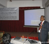 dr. sinha presents his paper.jpg
