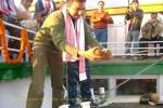 "Shekhar Aiyar smashing a coconut on the occasion at SB ""Shahnaz"""