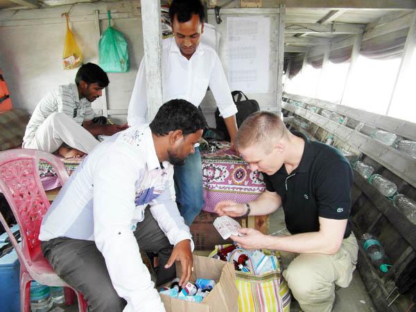 John Hugh Brent Grotrian looking at medical supplies of the Morigaon halth team onboard
