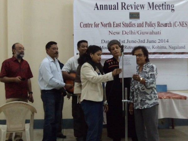 Trustees and staff singing Jamica farewell at the cultural evening on the final day of the meet