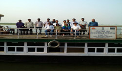 The Kamrup health team with the visitors on board Boat Clinic Kaliyani