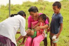 Damayanti Das, an Auxiliary Nursing Midwife who has been with C-NES's Dibrugarh Boat Clinic since 2008, effortlessly gives a child a required vaccination