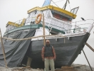 Akha under repair with its Master, Kapilash , in the foreground at Maijan Ghat, Dibrugarh, Nov 2009