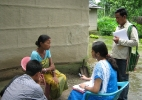 Riturekha Baruah,Jr. Researcher ,Assam (in blue) interviewing a victim of conflict situation .