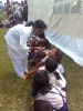 Children of Lowkiwali Feeder School being given Vitamin A at a health camp in Dibrugarhs Mesaki Sapori.