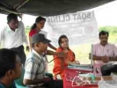 PFI officials Satyavrat Vyas(sitting extreme right) and Chandni Malik( sitting, in red outfit) at a health camp in Barpeta district.