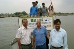 Sanjay Sharma, C-NES\' Asociate Programme Manager ( left) Mr Chaman Lal (Middle) and Mehbub Alam Hazarika, DCO Dhubri (Right) set for a camp to Chalakhura River Block in  Dhubri district from  Mela ghat.   A few boat clinic team members seen behind.