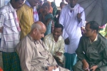 Chaman Lal, C-NES Trustee and former Special Rapporteur at the National Human Rights Commission, also former DGP, Nagaland,on a boat clinic review mission  in May 2009. Seen here( sitting left) at Barpeta with local panchayat menmbersand villagers and associate Programme manger Sanjay Sharma (seated right)