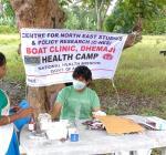 Pharmacist-Narayan-Acharjee-giving-medicine-to-patient