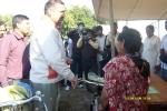 The Deputy Commissioner Dibrugarh, Mr GD Tripathy distributing bicycles to Accredited Social Health Activists (ASHA\'s) during a Pulse Polio Immunization campaign at  Sarikholia sapori
