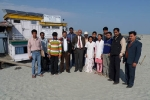 C-NES Trustee Mr Chaman Lal with the Dhemaji Boat Clinic Team at Dibrugarh\'s Maijan Ghat.with Boat Clinic SB Shahnaz as the backdrop.