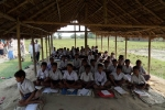 Primary level children of Lowkiwali sapori feeder school in Dibrugarh attending classes.