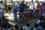 An enthusiatic child washing his hands with soap  as part of the global hand washing day at Tinsukia\'s Laika Pomua L P School, helped by Sanjay Sarma, Associate Programme Manager(in blue T shirt). Hiranya , DPO Boat Clinic  looks on.