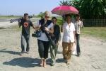 French TV journalists  Laetitia and Lise walking to a health camp at Tinsukia\'s  Laika Pomua sapori