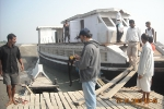 Sanjoy Hazarika inspecting the new boat being built for the Jorhat Boat  Clinic, (donated by Oil India Ltd) at Kamalabari Ghat
