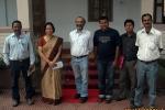 The former Jorhat Deputy Commissioner L S Changsang ( in a saree) with   Sanjoy Hazarika and C-NES staff (from left) Ashok Rao, Mirza Zulfikar, DPO Jorhat Boat Clinic. Probin Chamuah and Sanjay Sarma.