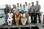 Anna (sitting middle) with the Jorhat Boat Clinic team at Sikari Ghat.
