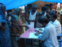 Health camp in progress on 29th October, 2008 at the Berabhanga Sapori in Dhubri. The attending doctors are Dr Ganesh Chandra Das (sitting extreme right) and Dr Abdul Warish