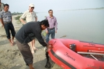 Binod Razak, Community worker, Tinsukia offering prayers before the speed boat launch as Leeman, Sanjay Sharma, Associate Programme Manager and Sasi Pamegam, Boat crew member, Jorhat looks on