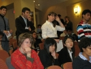 A long queue of students and participants wait to ask questions of the panel