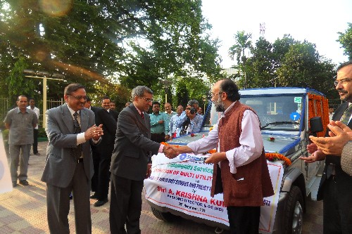 A Krishna Kumar, Managing Director SBI handing over the keys to Sanjoy Hazarika